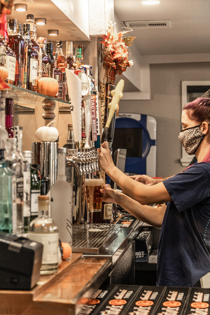The Bartender pouring a beer in Freddy J's Bar & Kitchen in Mays Landing, NJ